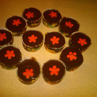 Ganache Cupcakes french vanilla cake filled and topped with dark chocolate ganache and a fondant flower