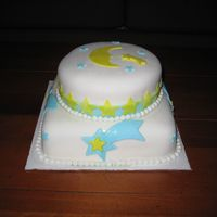 My Second Fondant Cake   Just for fun, moons and stars. Vanilla rum cake, white fondant, teal and yellow fondant.