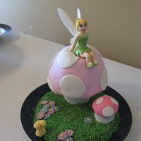Tinkerbell Birthday Cake   I made this cake for a friends birthday. Gumpaste fondant mix for tink and mmf covered cream cake for the mushrooms. tfl.