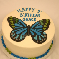 Butterfly Invitation The butterfly is copied from the invitation for this chocolate cake with white icing.