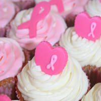 3-Day Breast Cancer Cupcakes Strawberry cupcakes with almond buttercream and a candy ribbon or heart. These were made as a fundraiser for the Breast Cancer 3-Day walk...