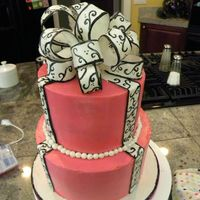 Pink Scroll Bow Cake THis cake was hard! It didn't turn out just like I wanted but I like it anyways. The cake is pink buttercream and the bow is fondant (...