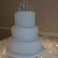 Ivory Wedding Covered with Fondant, piped with royal.