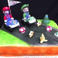 Mario Kart 1/4 sheet BC with fondant accents except for the flag and karts, they are gumpaste.