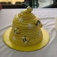 Bee Hive 80th Birthday cake for the lady who sells honey at the farmer's market I sell at. Chai tea cake with honey cinnamon SMBC. Fondant bees...