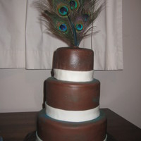 Peacock Cake All she said was.. peacock feathers (not the peacock animal itself).. brown, and ivory. This is what she got. :)