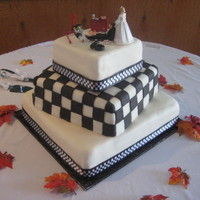 Race Car Theme Wedding Cake.   She wanted the checkered flag effect on the middle tier. Chocolate cake/bavarian filling.