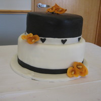 Black/burnt Orange Calla Cake Wedding colors, wedding flower is the orange calla lilies (which are gumpaste)
