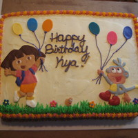 Dora Decorations made with fondant, piped buttercream grass.