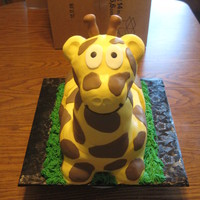 Giraffe! Yellow cake carved, covered in buttercream fondant, fondant spots, gumpaste little nubbies on his head. The head is fondant covered...
