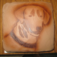 Sampson! This is chocolate ganache.. outline of dog head painted with airbrush, inside detail done by hand with paintbrush.
