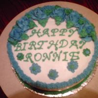Cake_For_Ronnie.jpg Cake was made for co-worker's husband. Buttercream Icing with strawberry cake