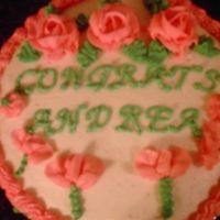 Cake_For_Grad.jpg Cake was made for a co-worker who graduated from college. I'm still learning!!