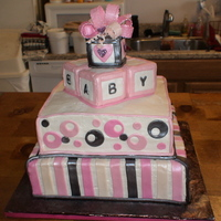 Baby Block Cake  12 inch on 14 inch square cakes. Blocks are made from Rice Krispie treats and fondant details. Airbrushed pearl with disco dust on the...