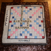 Scrabble Grammy's unfinished Scrabble cake. I wanted to do the details such as double triple word and letter score written on the blocks but my...