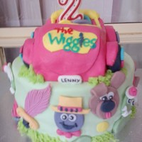 Wiggles 2Nd Birthday Cake  rainbow sponge cake with buttercream and fondant icing. All decorations are made of fondant. The car is a vanilla butter cake covered in...