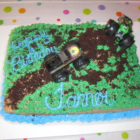 Monster Truck 7Th Birthday This was a single layer marble, chocolate and white, cake with buttercream icing.