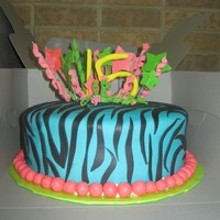 15Th Birthday Zebra 15th birthday cake. This was a white cake that was made to look like tie dye with buttercream and fondant.