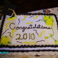 Graduation Party Cake Buttercream icing. Small rose tip 101 was used to put streamers on it and added some roses.