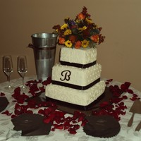 Chocolate Brown And White Wedding Cake Fall wedding cake. All butter cream. Tiers are WASC cake, Pumpkin Spice, and Carrot. All tiers were filled with cream cheese filling. It...