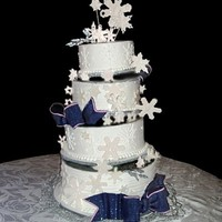 Snowflake Wedding Off set tiers Gumpaste bows and snowflakes