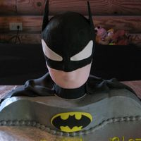 Batman Cake  This 3D cake of Batman is constructed from fondant, buttercream icing, and royal icing. The body if made of cake covered in buttercream...