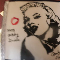 Marilyn Monroe Birthday Cake Hand painted Marilyn with airbrush paint. The kiss was made by making a potato stamp. You cant see from the picture but the bling is around...