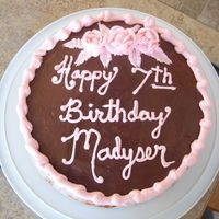 Daughters Birthday Double laver marble cake with chocolate frosting and pink roses! My writing needs a bit more practice, My daughters name is Madysen not...