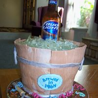 Bucket With Beer This is a birthday cake I made for my boss. Red Velvet. My first sugar piece.