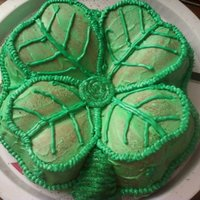 Four Leaf Clover nonalcoholic irish cream cake made with bailey's coffee creamer. baked in a 4 leaf clover shaped pan. tried to use a green glaze but...