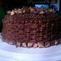 Reese's Basket Cake Chocolate cake with peanut butter fluff and chocolate chip filling. chocolate buttercream and reese's peanut butter cups chopped on...