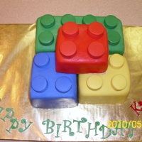 Kyle's Lego Birthday Cake WASC white and chocolate covered with fondant. Had never done a square cake with fondant before so it was a learning experience! Needless...