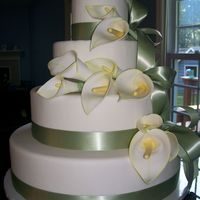 Calla Lilly Wedding Cake   Giant Gum Paste Calla Lillies (hand painted)on 4 tiers of fondant with satin ribbon detail.