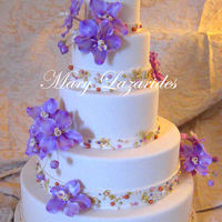 Wedding Cake With Gumpaste Orchids And Pearls This was a cake I made for the Connecticut Cake Competition last February. It actually won grand prize. I was very proud of this cake.