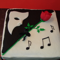 Phantom Of The Opera Square cake with white modeling chocolate mask and silk rose.