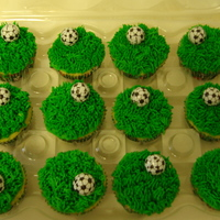 Soccer Cupcakes yellow cake with green buttercream frosting. store bought chocolate soccer balls