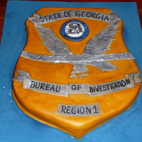 Gbi Badge I made this for my husband for an office dinner. It was two sheet cakes, cut and carved, covered in fondant, and painted with diluted gel...
