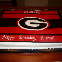 Georgia Bulldogs GA Bulldog sheet cake for a coworker's birthday. Iced in BC, fondant on top.