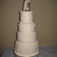 "Elegant Ivory Wedding Cake The bride wanted something understated, but not entirely plain, with a monotone color scheme in ivory. Cake Tiers: 12"" WASC with..."