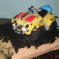Atv This is an ATV cake made for a Birthday. It was designed to look like the one the birthday 'man' has. It was quite fun to make...