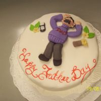 Another Father's Day Cake! This is a single version of my office buddies, but only one figure. This one is sleeping on a kind of pillow, with his cellphone by his...