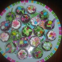 Sany0077.jpg Brownie bites I made and decorated for my Easter dessert buffet. Buttercream frosting