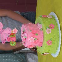 Dscn3622.jpg BC frosting with fondant flowers - Thank you Sugartopped for the idea! My daughter loved it!