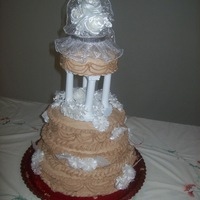 Mom's Wedding Cake  This was my first attempt at a stacked and wedding cake. Other than putting my hand hand marks in the bottom back in the process of...
