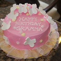 My Grams B-Day Cake   I just made fondant butterflys, let them set a couple of days and used royal icing to stick them to the cake-which is pink buttercream.