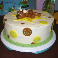 Moose & Sunflower Cake 10 in round vanilla cake with vanilla buttercream. With mmf moose, sunflower and polka dots