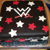 Wwe Cake 10in square with buttercream and Chef Duff's Black Buttercream Icing. Logo is buttercream and stars are MMF