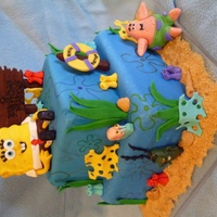 "Sponge Bob Square Pants  10"" and 6"" square cakes covered in Michele Foster's fondant. Sponge Bob and other characters made of modeling chocolate and..."
