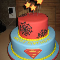 Superhero Birthday Cake super hero cake for a childs 3rd birthday.. covered in fondant. The bottom tier has a superman cape coming off of the backside