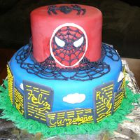 Spider Man Blue and red Spider Man cake with a city scape.